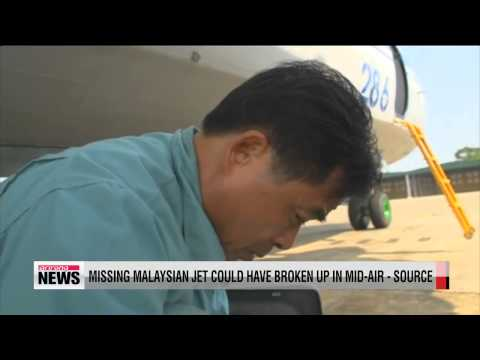 Missing Malaysian jet could have broken up in mid-air - source