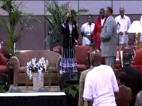 Evangelist Glenda Adams sings at the NCFJ Holy Convocation 2009