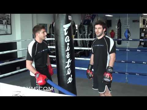 Muay Thai and MMA - Defense and Counter Attack Drill w/ Heavy Bag and Batons Image 1
