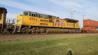 UP 4587 a SD70M and UP 8904 a SD70AH lead a stack train west through Geneva IL