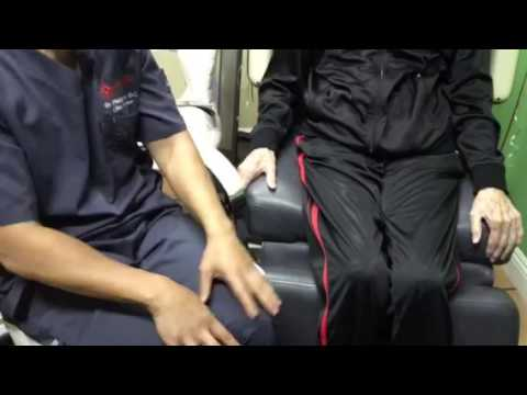 Dr. Yoo demonstrates how to do knee exercises for bow legs & knock knees