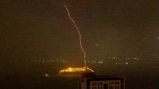 Lightning strikes Hong Kong harbour during March 30, 2014 storm