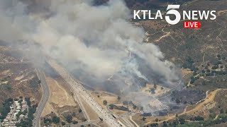 Crews battle Elsmere Fire near 14 Freeway in Santa Clarita