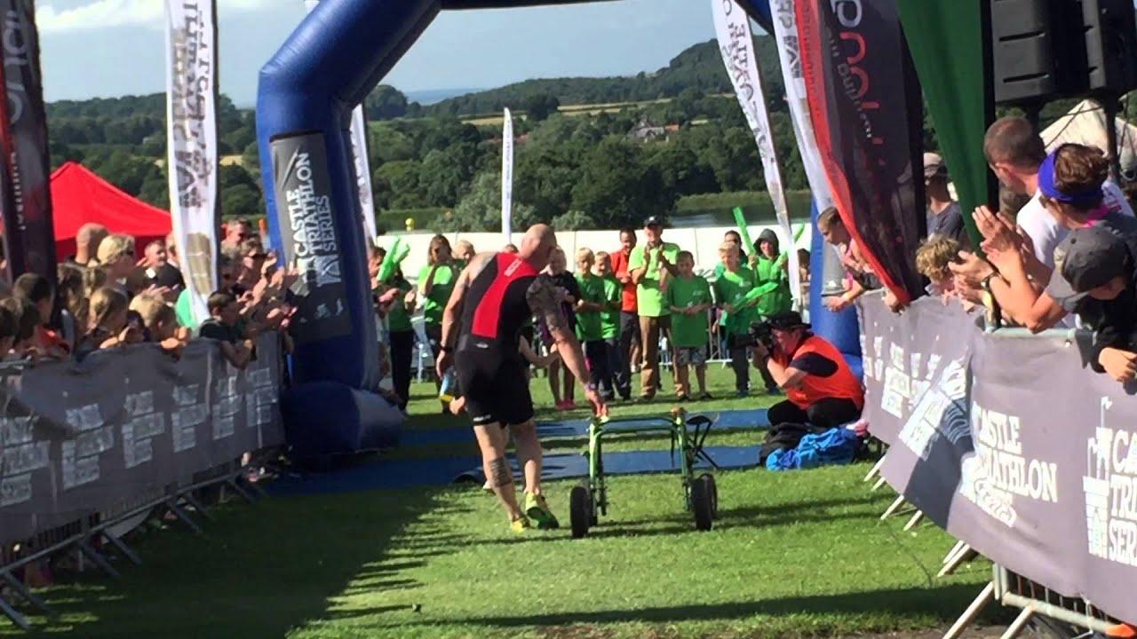 Bailey Matthews aged 8 with Cerebral Palsy finishing Triathlon