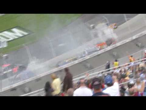 Joey Logano gets turned into the grass and barrel rolls after crossing into Reed Sorenson's path.