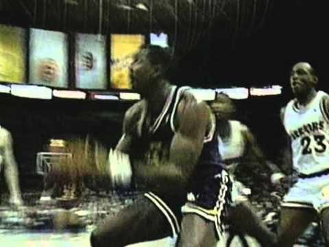 Manute Bol smashes Karl Malone's shot off the backboard, gets fouled by the frustrated Mailman and gets loud cheers for making a free throw. May 2, 1989. Wes...