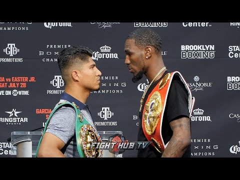 ROBERT EASTER JR TOWERS OVER MIKEY GARCIA IN FACE OFF DURING KICK OFF PRESS CONFERENCE
