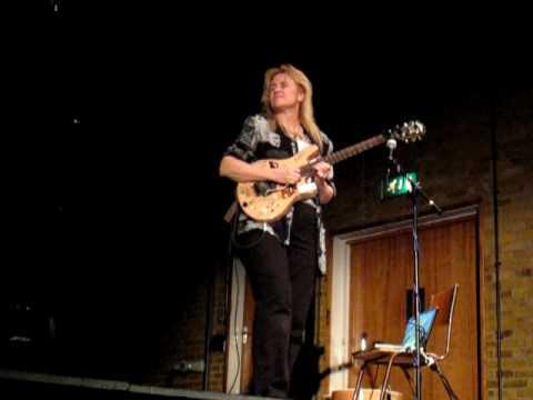 Jennifer Batten playing guitar at Colchester Institute