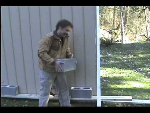 Bulletproofing Your House - M4 Vs. Cinder Blocks and Wall.