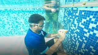 20-year-old sets world record for solving puzzle underwater