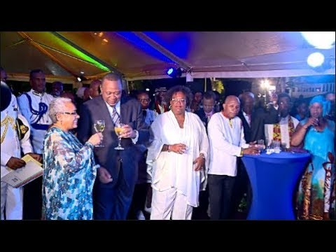 PRESIDENT UHURU & MARGARET TOASTING IN BARBADOS AT A PARTY HOSTED BY BARBADOS GOVERNOR!