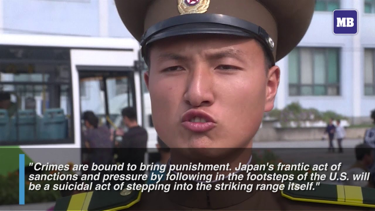 North Koreans react to missile launch