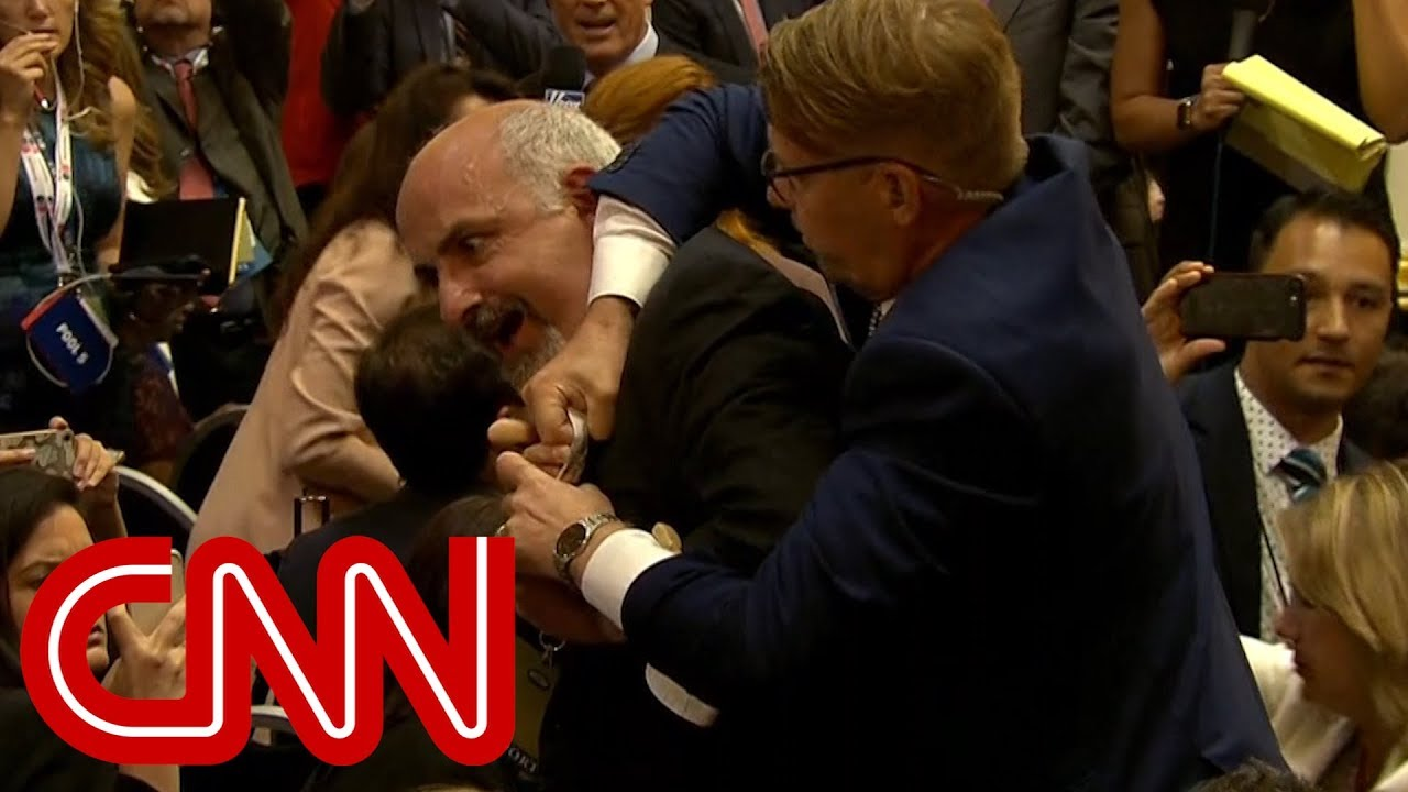 Man forcibly removed from Trump-Putin press conference