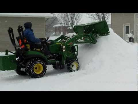 john deere 1026r plowing snow 1