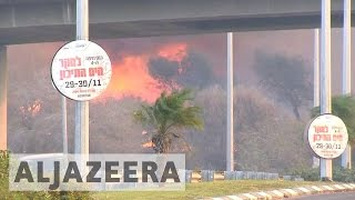 Israel: Thousands ordered to leave after massive fires hit Haifa