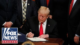 Trump reaffirms need for border wall funding, signs farm bill