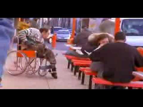 Handicapped man eat a dead pigeon