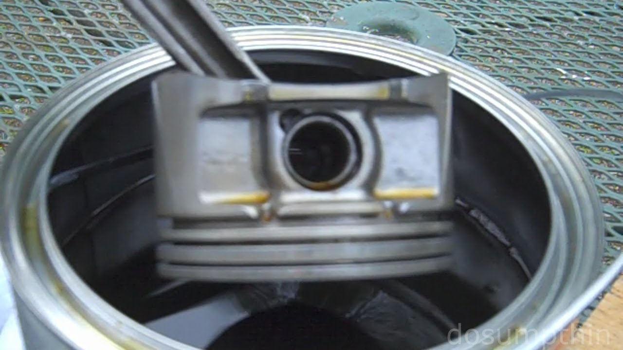 dissolving carbon buildup  pistons cleaning piston ring grooves engine rebuild compression