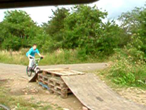 Bike jump on homemade ramp youtube for What is dirt made out of