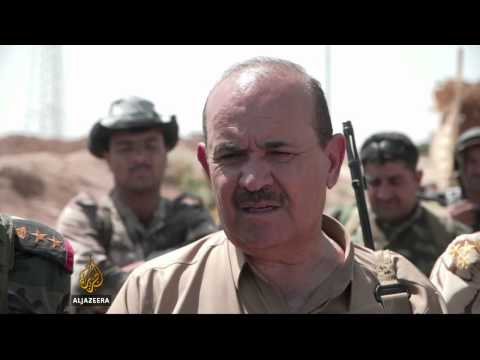 Kurdish fighters key in fight against rebels
