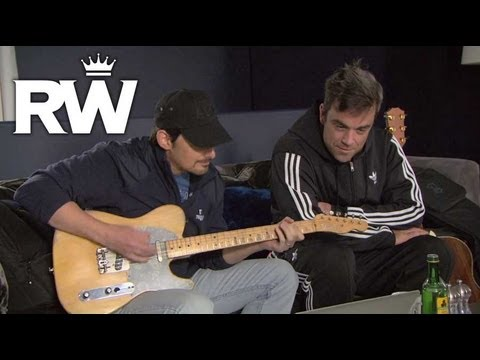 Thumb Robbie Williams and Brad Paisley practice singing the song for Cars 2