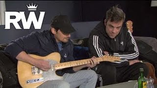 Robbie Williams y Brad Paisley practican la canción para Cars 2
