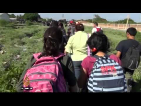 Obama in appeal to stem child migrant numbers