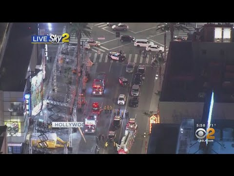 Man Climbs Scaffolding On Hollywood Boulevard Partially Closing Road