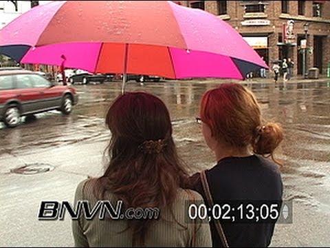 8/11/2005 People in the rain in Uptown Minneapolis, MN