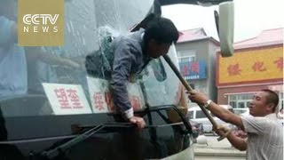 Watch: Man gets stuck in bus windscreen after reportedly ramming glass