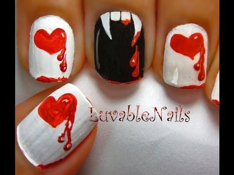 Vampire/Dracula teeth, red hearts with dripping blood drops nail art