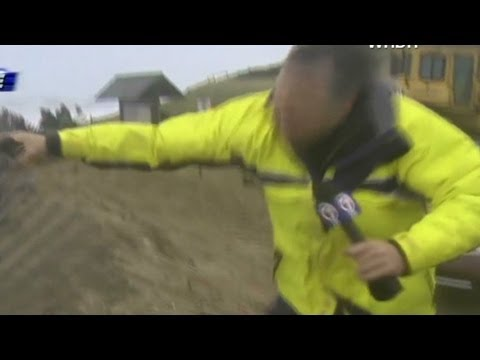 Reporters hang on for dear life in Hurricane Sandy