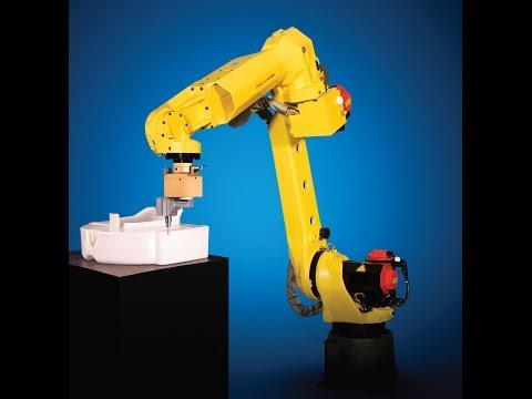 A robot building a robot رجل آلي يصنع رجل آالي