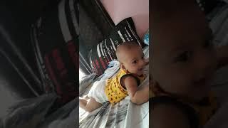 4 months cute baby playing