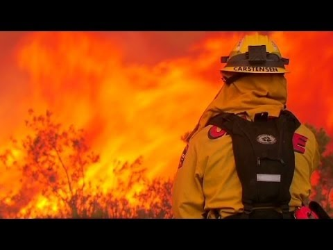 Residents flee San Diego wildfires