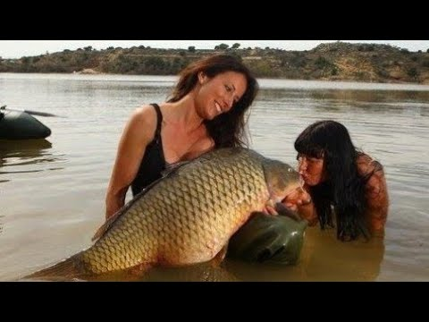 SEXY GIRL FISH A BIG CARP OVER 60 LBS PART ONE - HD by YURI GRISENDI