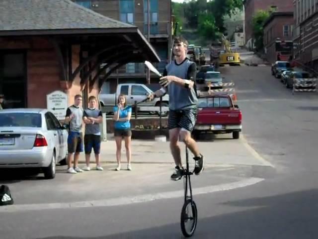 knive juggling on a giraffe unicycle!