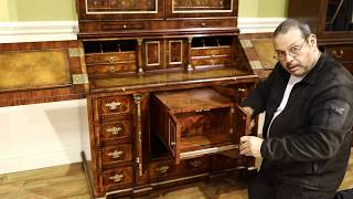 Secretary desk with secret compartments. Brass and leather top slant-lid desk