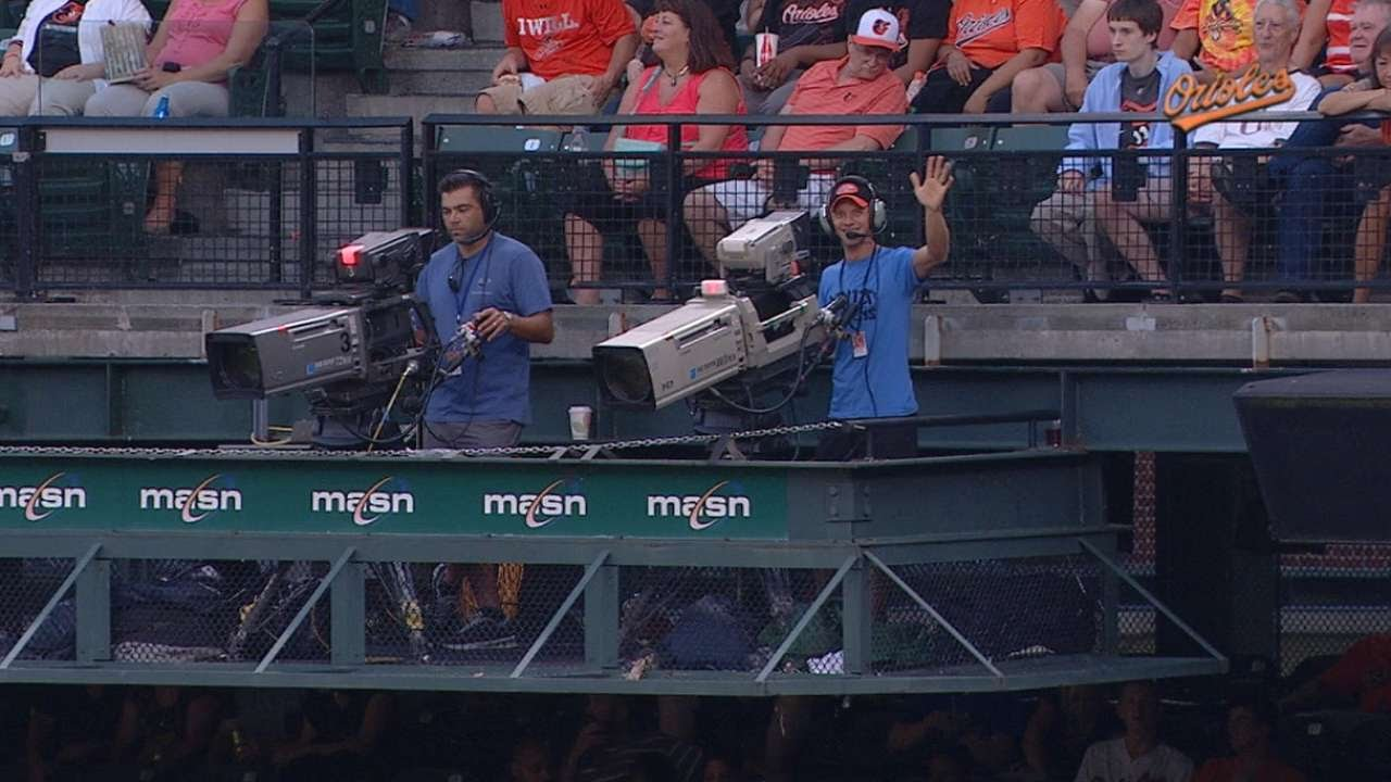 Cameraman, Ninja Warrior tosses first pitch