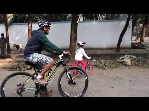 Miraal and I biking in  Gulshan Dhaka