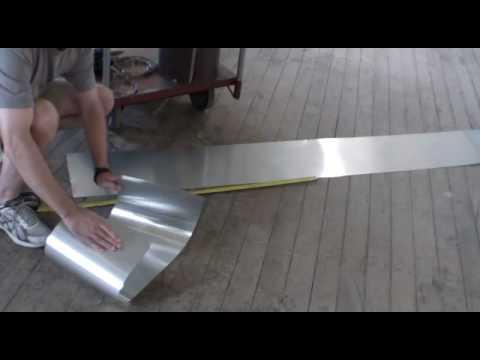 Temporary muffler repair patch with aluminum sheet