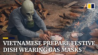 Vietamese prepare claypot carp for Lunar New Year while wearing gas masks