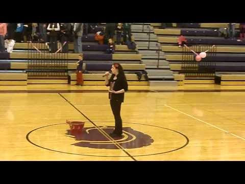Bronsyn singing The National Anthem at a Fowlerville High School basketball game