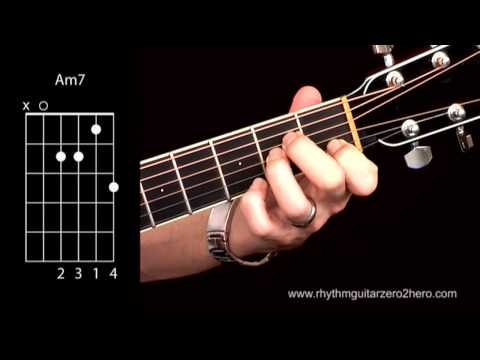 Learn Guitar Chords: Am7 - Beginner Acoustic Guita.