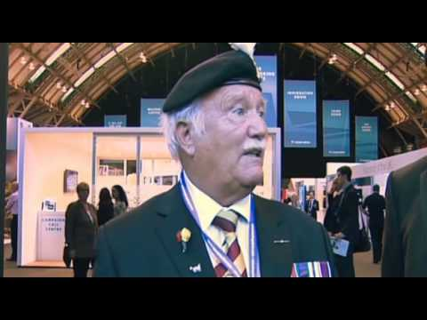 Philip Hammond heckled by  retired army officer.Tory conference