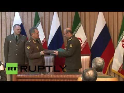 Iran: Russia's Shoigu signs military cooperation pact with Iran's Dehghan