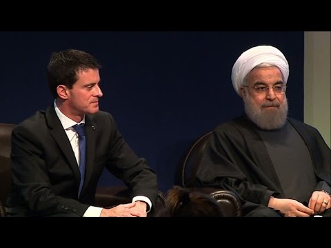 Iran President Rouhani greeted by French PM