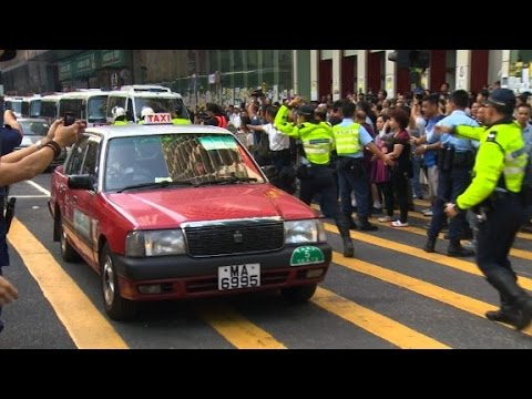 Hong Kong: Cars roll down cleared protests sites
