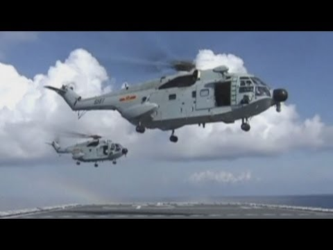 Malaysia Airlines crash: Navy ships and helicopters search for missing flight MH370