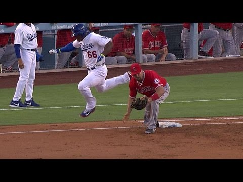 Puig and Pujols get feet tangled at first